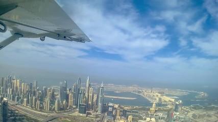 Wall Mural - Aerial view of Dubai from plane, Palm Jumeirah and Dubai Marina skyline - Video HD