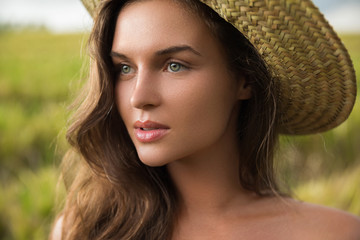 Young lovely woman wearing straw hat