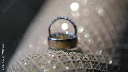 Diamond wedding ring with light leaks and flares macro