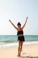 Stylish and beautiful woman on the beach