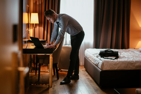 Businessman working from hotel.  Executive manager on his latop.