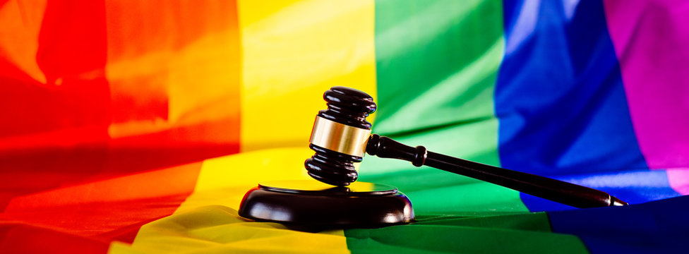 Woden judge mallet symbol of law and justice with lgbt flag