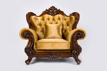 Luxurious vintage gold armchair on white background