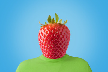 A man with a strawberry instead of head. Minimal summer concept.