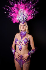 young woman wearing colorful samba costume and headpiece