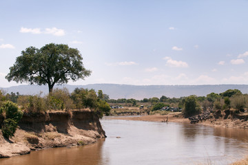 A mara river view with tourists waiting for the migration, Kenya