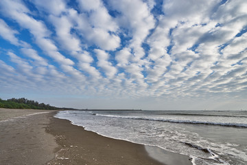 Beautiful scenics of Qiaotou Beach with flowing clouds and waves from the south china sea at Qiaotouhaitan park in Tainan, Taiwan.