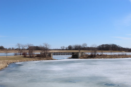 Foot bridge over a frozen lake at Independence Grove in Libertyville, Illinois