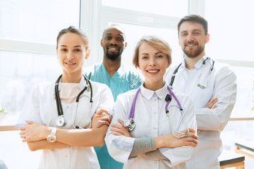 Healthcare people group. Professional male and female doctors posing at hospital office or clinic. Medical technology research institute and doctor staff service concept. Happy smiling models.