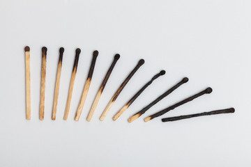 Matches forming falling sequence on slightly gray background