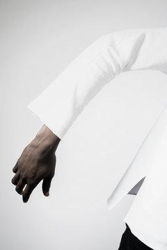 Hand of man wearing white jacket