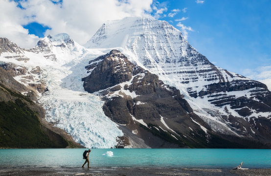 Hiker walking along Berg Lake, Canada