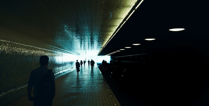 Anonymous people taking an underpass at the station