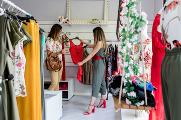 Women in a modern shop looking for the right dress