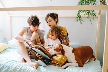 Gay family having fun at home