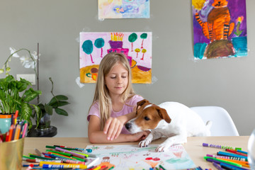 Child drawing with color pencils