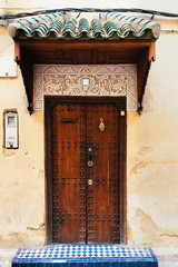 Traditional door with decorations of moroccan house