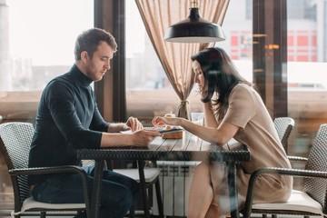 Couple at restaurant having dinner