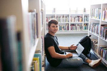 Highschool teenager student studying in library