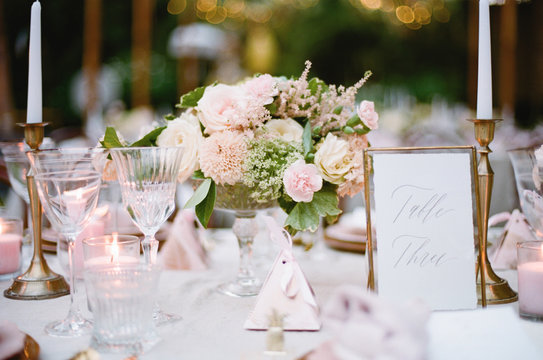 Elegant Outdoor wedding tabletop with florals