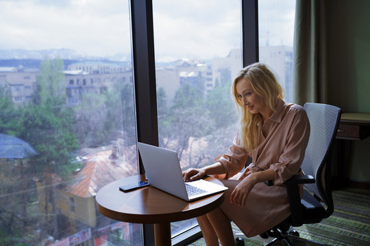 Businesswoman using laptop while working at the office