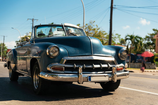 Blue old car running in the streets of Havana Cuba.