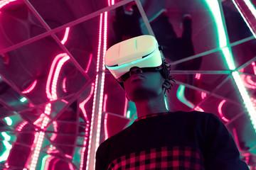 Black man in VR headset in neon