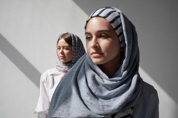 Portrait of two women wearing hijabs