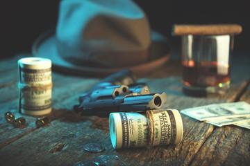 Guns and money.Whiskey glass, gangster coat,bullet,cigar,dollars .The concept of crime