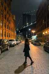 Women walking on the streets of Dumbo at night