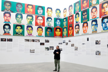 """Chinese artist Ai Weiwei poses for photographers during a photocall for his exhibition """"Restablecer Memorias"""" displayed at MUAC in Mexico City"""