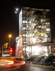 A long exposure picture shows cars of German automobile manufacturer Smart displayed in a glass tower showroom of Kenny's Auto-Center AG company in Wallisellen