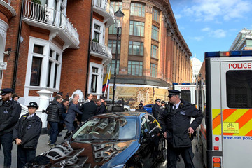 WikiLeaks founder Assange is carried by Metropolitan Police officers during his arrest in London