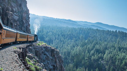 The Durango-Silverton train, Colorado (USA), moving slowy across rocks and cliffs