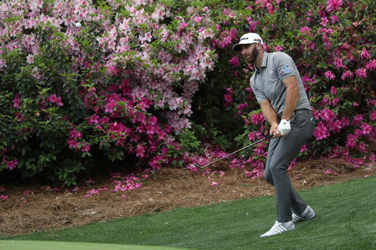 Dustin Johnson of the U.S. chips onto the 13th green during first round play of the 2019 Masters golf tournament at Augusta National Golf Club in Augusta, Georgia, U.S.