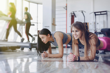 girls in the gym stand in plank Wall mural