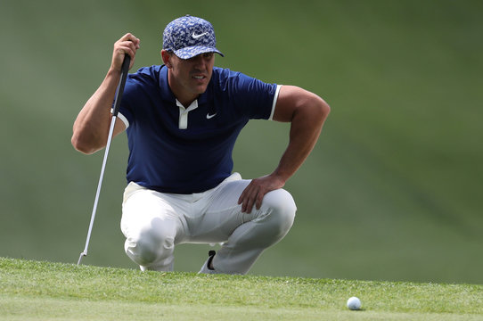 Brooks Koepka of the U.S. looks at his putt on the 7th green during first round play of the 2019 Masters golf tournament at Augusta National Golf Club in Augusta, Georgia, U.S.