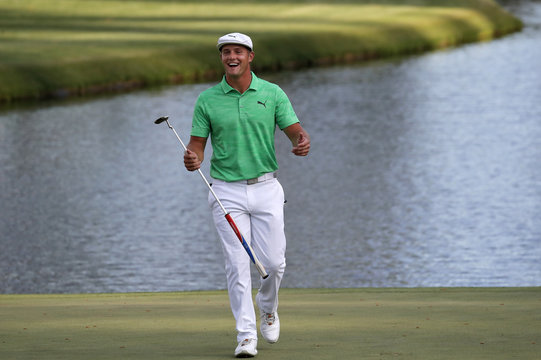 Bryson DeChambeau of the U.S. celebrates on the 16th green during first round play of the 2019 Masters golf tournament at Augusta National Golf Club in Augusta, Georgia, U.S.