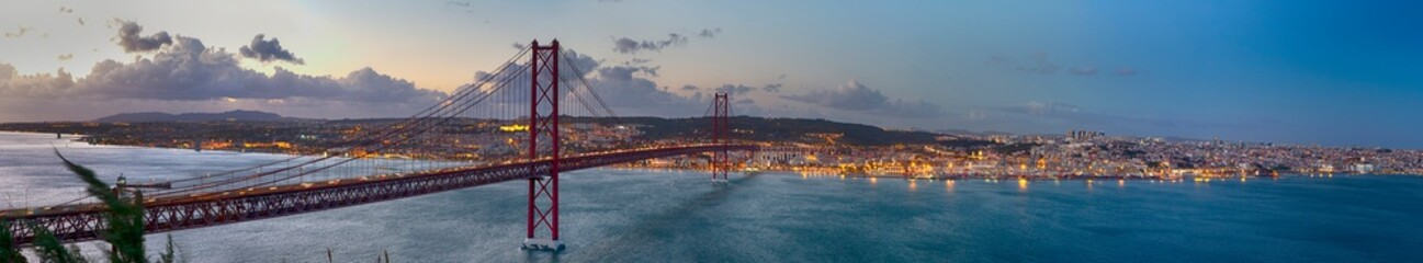 Crossing The Tagus River. Amazing Panoramic Image of Lisbon Cityscape Along with 25th April Bridge (Ponte 25 de Abril). Taken from Almada District Fototapete