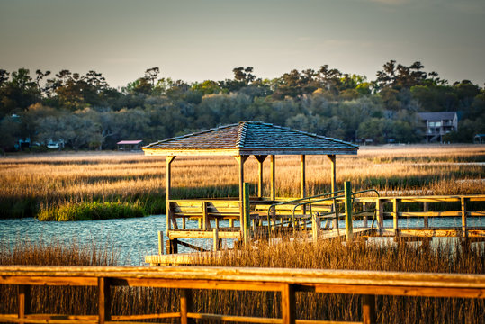 A covered dock on a creek in a salt-marsh in the low country of South Carolina.