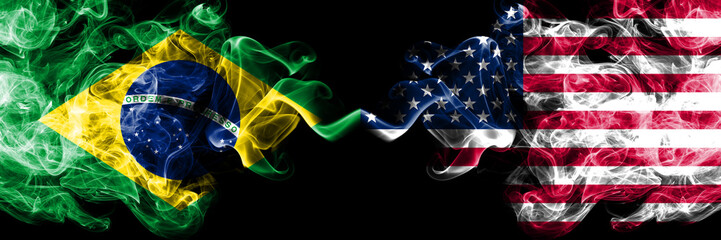 Brazil vs United States of America, American smoke flags placed side by side. Thick colored silky smoke flags of Brazilian and United States of America, American