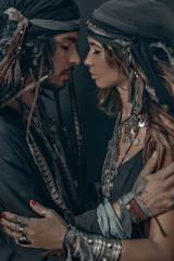 stylish fashionable young handsome man and woman. gypsy fashion concept