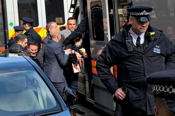 WikiLeaks founder Assange is handled by Metropolitan Police officers during his arrest and taken into custody following the Ecuadorian government's termination of asylum, in London