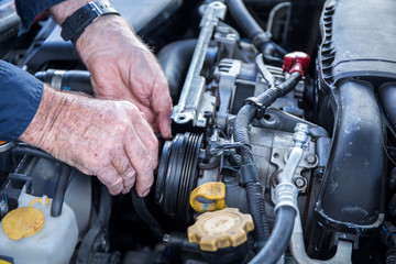 Close Up Photo Of Mechanic Repairing Car