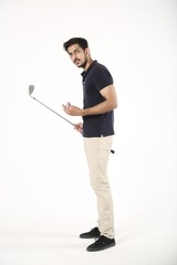 Side pose of young boy with golf stick and golf ball. Isolated on white background.