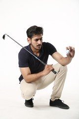Handsome boy holding golf stick and golf ball . Isolated on white background.