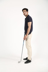 Young boy standing on the floor with golf stick in hand. Isolated on white background.