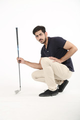 Picture of handsome boy holding golf stick in hand. Isolated on white background.