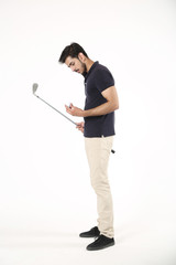 Side pose of boy standing with golf stick and golf ball. Isolated on white background.