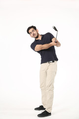 Picture of handsome boy playing with golf stick. Isolated on white background.